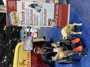 U.S. Navy Veteran and America's VetDogs client Joe Worley with service dog Galaxie at Bil-Jac's exhibit at Global Pet Expo in Orlando, Florida 2019.