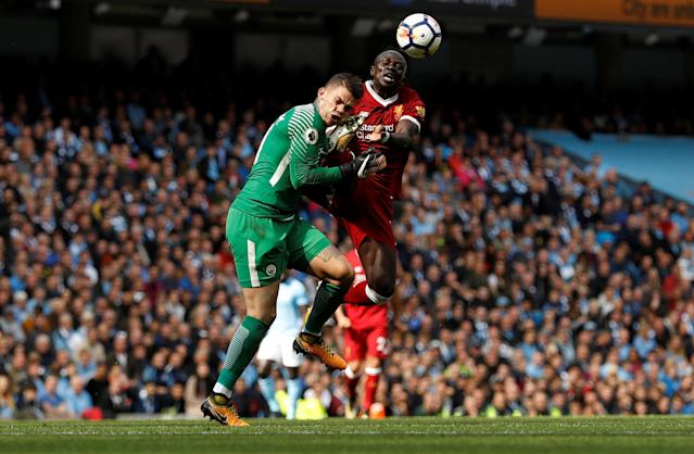<p>Manchester City's Ederson Moraes is fouled by Liverpool's Sadio Mane </p>