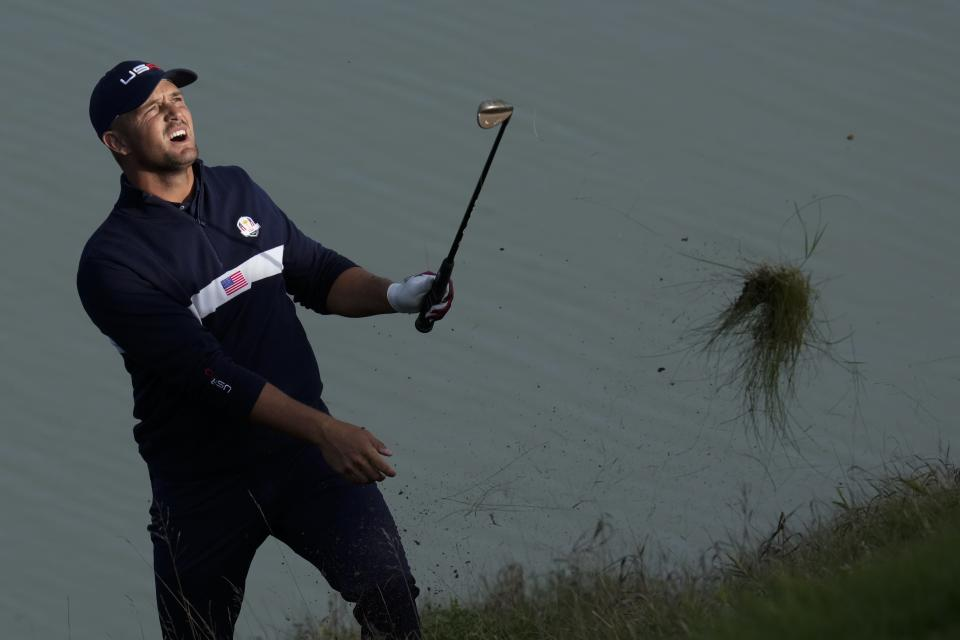 Team USA's Bryson DeChambeau hits to the 12th hole during a four-ball match the Ryder Cup at the Whistling Straits Golf Course Saturday, Sept. 25, 2021, in Sheboygan, Wis. (AP Photo/Ashley Landis)