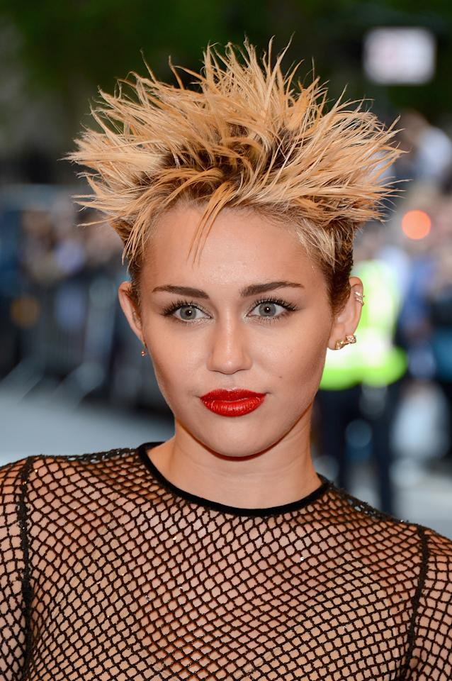 "<p><b>#20. </b>When <b>Miley Cyrus</b> showed up at the Met Gala with this spiked up hairstyle, we couldn't tell if she was going for boy band circa 1999 or <a href=""https://stylecaster.com/met-gala-2013-celebrity-doppelgangers-miley-cyrus-sarah-jessica-parker/"" title=""guy fieri"">Guy Fieri</a>. She does earn some points for the killer red lip, but we can't shake the feeling of wanting to say ""Bye, Bye, Bye"" to those frosted tips. </p>"