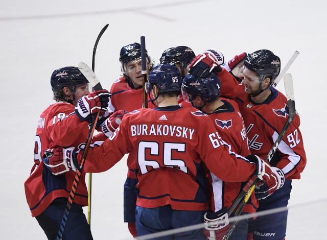 Washington Capitals defenseman Matt Niskanen (2) celebrates with center Evgeny Kuznetsov (92), of Russia, left wing Andre Burakovsky (65) and others after an NHL hockey game, Wednesday, Oct. 17, 2018, in Washington. Niskanen scored the game-winning goal in overtime. The Capitals won 4-3 in overtime. (AP Photo/Nick Wass)