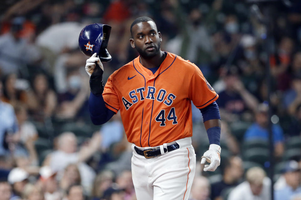 Houston Astros' Yordan Alvarez doffs his helmet after scoring on a single by Myles Straw against the Detroit Tigers during the second inning of a baseball game Tuesday, April 13, 2021, in Houston. (AP Photo/Michael Wyke)