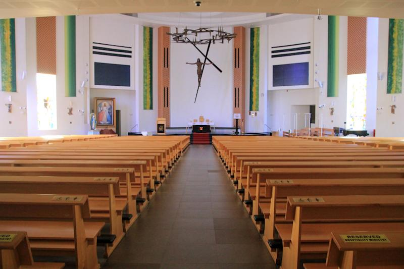 This photograph taken on February 23, 2020 shows empty pews inside the Roman Catholic Church after all public masses were indefinitely suspended as a protective measure to prevent the spread of the COVID-19 coronavirus in Singapore. - Health fears from the new coronavirus sweeping across the world have forced large public gatherings in Singapore like religious services to be cancelled. On February 15, the city-state's Roman Catholic archdiocese suspended all public masses indefinitely, offering pre-recorded services for the faithful to watch or listen to at home via YouTube or the church radio. (Photo by Martin ABBUGAO / AFP) (Photo by MARTIN ABBUGAO/AFP via Getty Images)