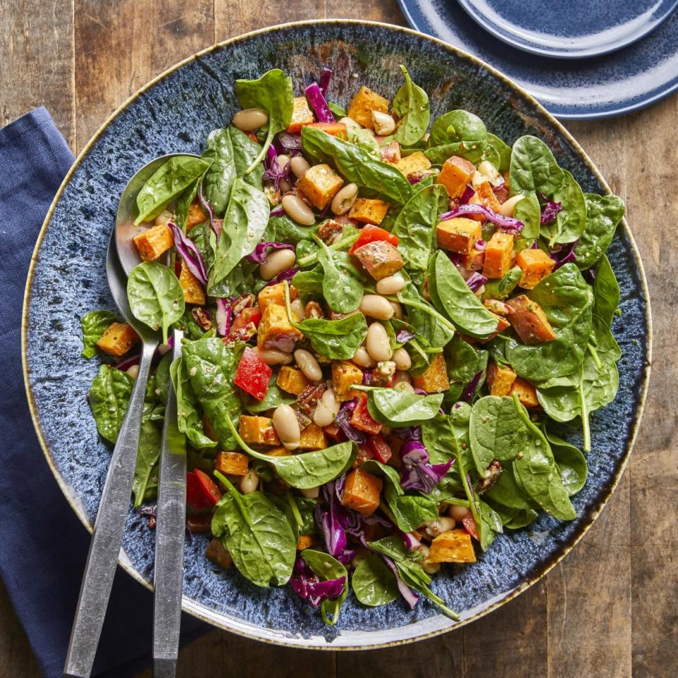 <p>Roasted sweet potatoes are paired with spinach, cabbage and white beans and tossed together with a bright basil dressing in this healthy main dish salad.</p>