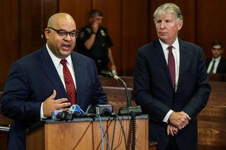 Neighborhood Defender Service of Harlem Seth Steed, (l), speaks at a news conference about dismissing some 3,000 marijunana smoking and possession cases in New York City, U.S., September 12, 2018. REUTERS/Jeenah Moon