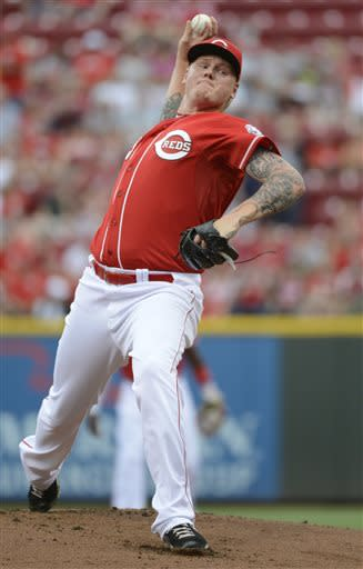 Cincinnati Reds starting pitcher Mat Latos throws in the first inning of a baseball game against the Seattle Mariners at Great American Ball Park in Cincinnati on Saturday, July 6, 2013. (AP Photo/Michael E. Keating)