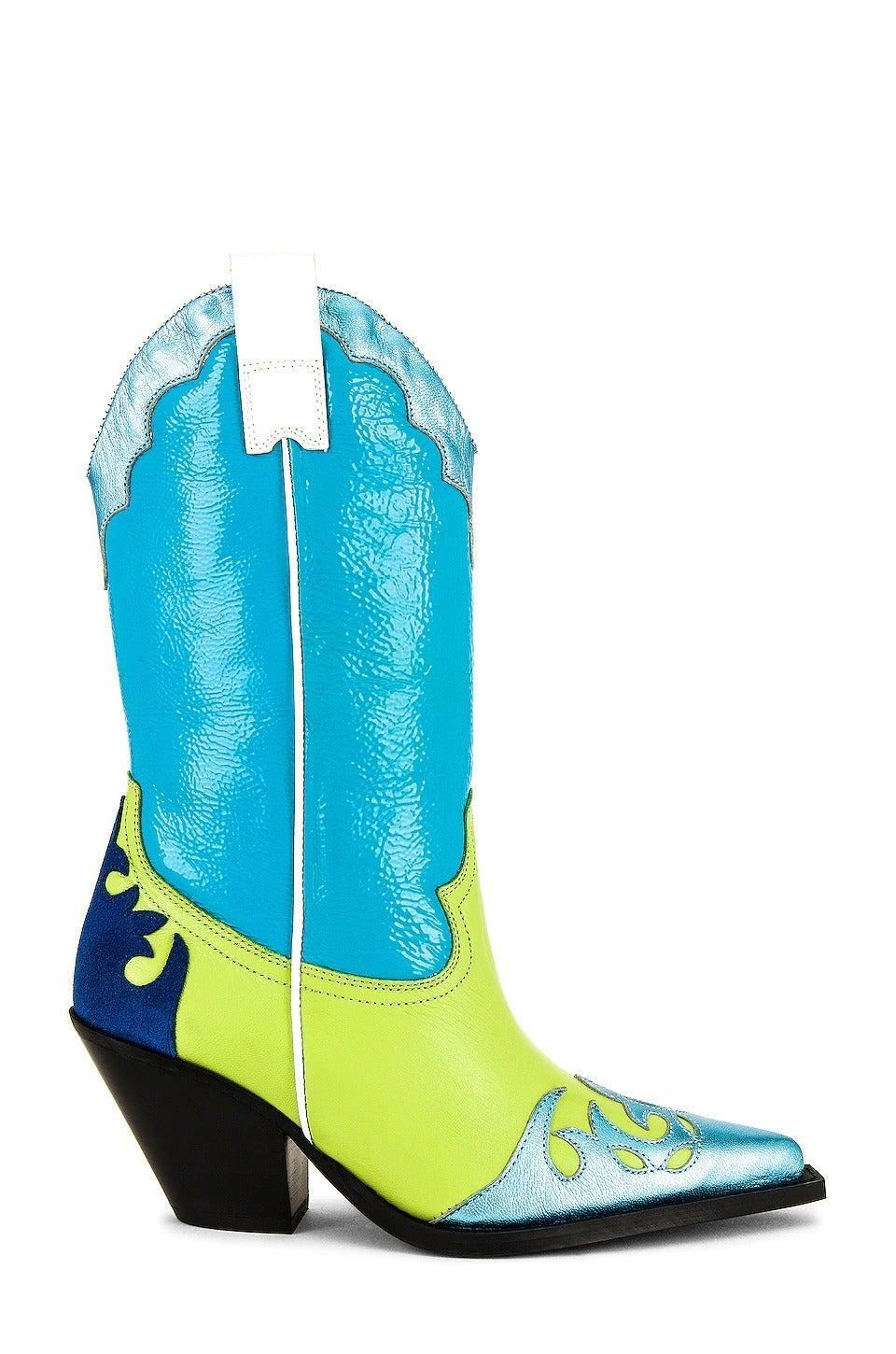 """<br><br><strong>Toral</strong> Western Boot, $, available at <a href=""""https://www.revolve.com/toral-western-boot/dp/TRAL-WZ25/?size=36"""" rel=""""nofollow noopener"""" target=""""_blank"""" data-ylk=""""slk:Revolve"""" class=""""link rapid-noclick-resp"""">Revolve</a>"""
