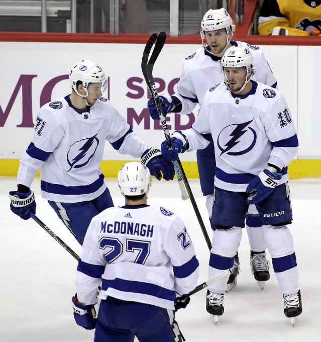 Tampa Bay Lightning's J.T. Miller (10) celebrates his goal during the third period of the team's NHL hockey game against the Pittsburgh Penguins in Pittsburgh, Wednesday, Jan. 30, 2019. The Penguins won 4-2. (AP Photo/Gene J. Puskar)