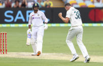 Australia's Josh Hazlewood, right, celebrates after dismissing India's Mayank Agarwal, left, during play on day three of the fourth cricket test between India and Australia at the Gabba, Brisbane, Australia, Sunday, Jan. 17, 2021. (AP Photo/Tertius Pickard)