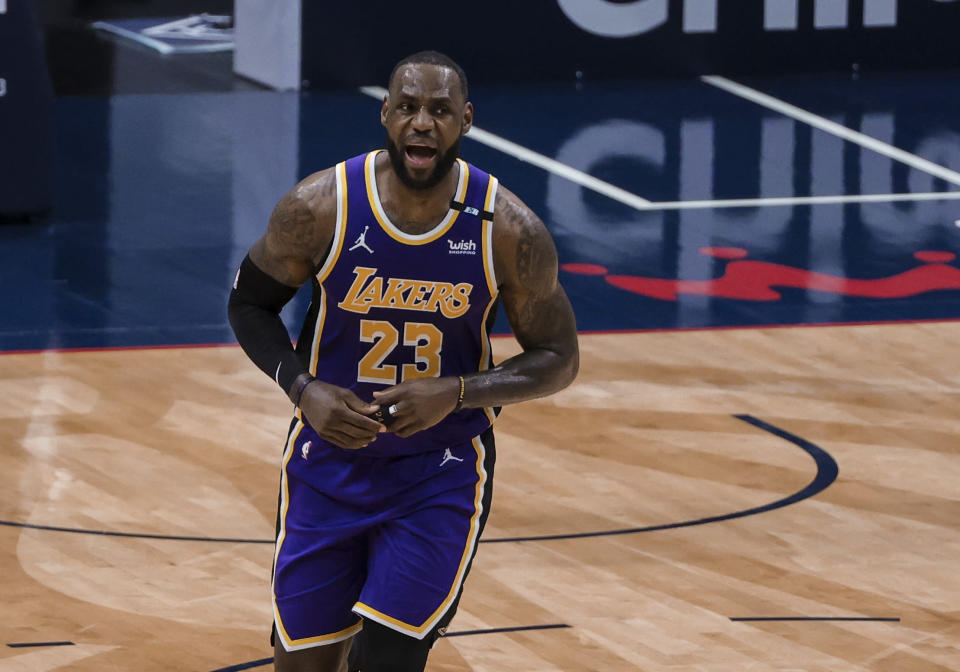 Los Angeles Lakers forward LeBron James (23) celebrates after scoring against the New Orleans Pelicans in the third quarter of an NBA basketball game in New Orleans, Sunday, May 16, 2021. (AP Photo/Derick Hingle)