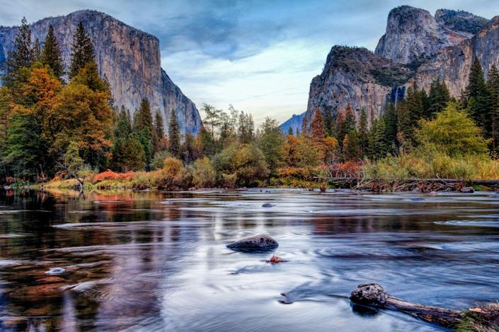 """<p>Autumn marks the ideal time for leaf peepers to visit Yosemite National Park as it's less busy and the bigleaf maple and black oak trees turn a darling bronze shade. A drive down Glacier Point Road will take you past aspens bursting in yellow tones while a stroll near the Badger Pass will end with views of gold and red. <br><br><em>Where to Stay: <a href=""""https://www.tenayalodge.com/"""" rel=""""nofollow noopener"""" target=""""_blank"""" data-ylk=""""slk:Tenaya Lodge"""" class=""""link rapid-noclick-resp"""">Tenaya Lodge</a> at Yosemite</em></p>"""
