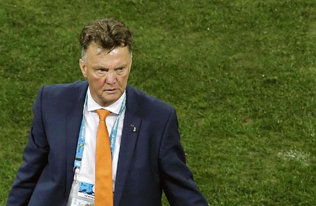 Netherlands' head coach Louis van Gaal returns to the bench during the extra time of the World Cup semifinal soccer match between the Netherlands and Argentina at the Itaquerao Stadium in Sao Paulo Brazil, Wednesday, July 9, 2014. (AP Photo/Hassan Ammar)