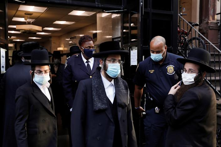 Members of the New York Police Department (NYPD) check the Congregation Yetev Lev D'Satmar synagogue, reportedly the original site of the wedding of the grandchild of Zalman Leib Teitelbaum, a grand rabbi of the Satmar Hasidic Jewish congregation, which was canceled due to restrictions on public gathering during the outbreak of the coronavirus disease (COVID-19) in the South Williamsburg neighborhood of Brooklyn, New York City, U.S., October 19, 2020. REUTERS/Andrew Kelly (REUTERS)