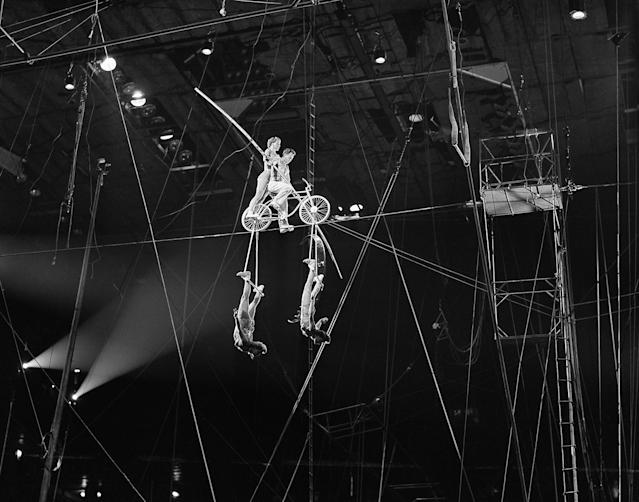 <p>Harold Alzanas on the bicycle during the high wire Alzanas act of the big show now attracting kids of all ages at Madison Square Garden, New York, April 12, 1951. (AP Photo/Ed Ford) </p>