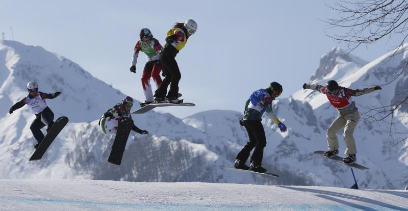 Lindsey Jacobellis, right, of the United States leads during the women's snowboard cross semifinal at the Rosa Khutor Extreme Park, at the 2014 Winter Olympics, Sunday, Feb. 16, 2014, in Krasnaya Polyana, Russia. The other riders are, from left, Britain's Zoe Gillings, Italy's Michela Moioli, Canada's Dominique Maltais, Bulgaria's Alexandra Jekova, and Australia's Belle Brockhoff. (AP Photo/Luca Bruno)