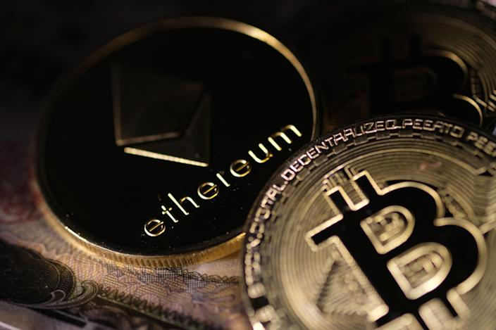 Bitcon and ethereum prices were down 4% on Friday. Photo: Yuriko Nakao/Getty Images