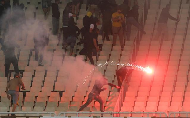 Soccer Football - Greek Cup Final - AEK Athens vs PAOK Salonika - Athens Olympic Stadium, Athens, Greece - May 12, 2018 Fans throw flares inside the stadium REUTERS/Costas Baltas
