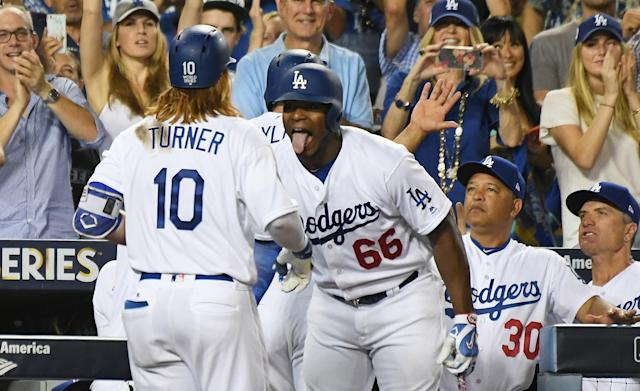 <p>Los Angeles Dodgers third baseman Justin Turner (10) celebrates after hitting a two run home run with right fielder Yasiel Puig (66) in the sixth inning against the Houston Astros in game one of the 2017 World Series at Dodger Stadium. Mandatory Credit: Richard Mackson-USA TODAY Sports </p>
