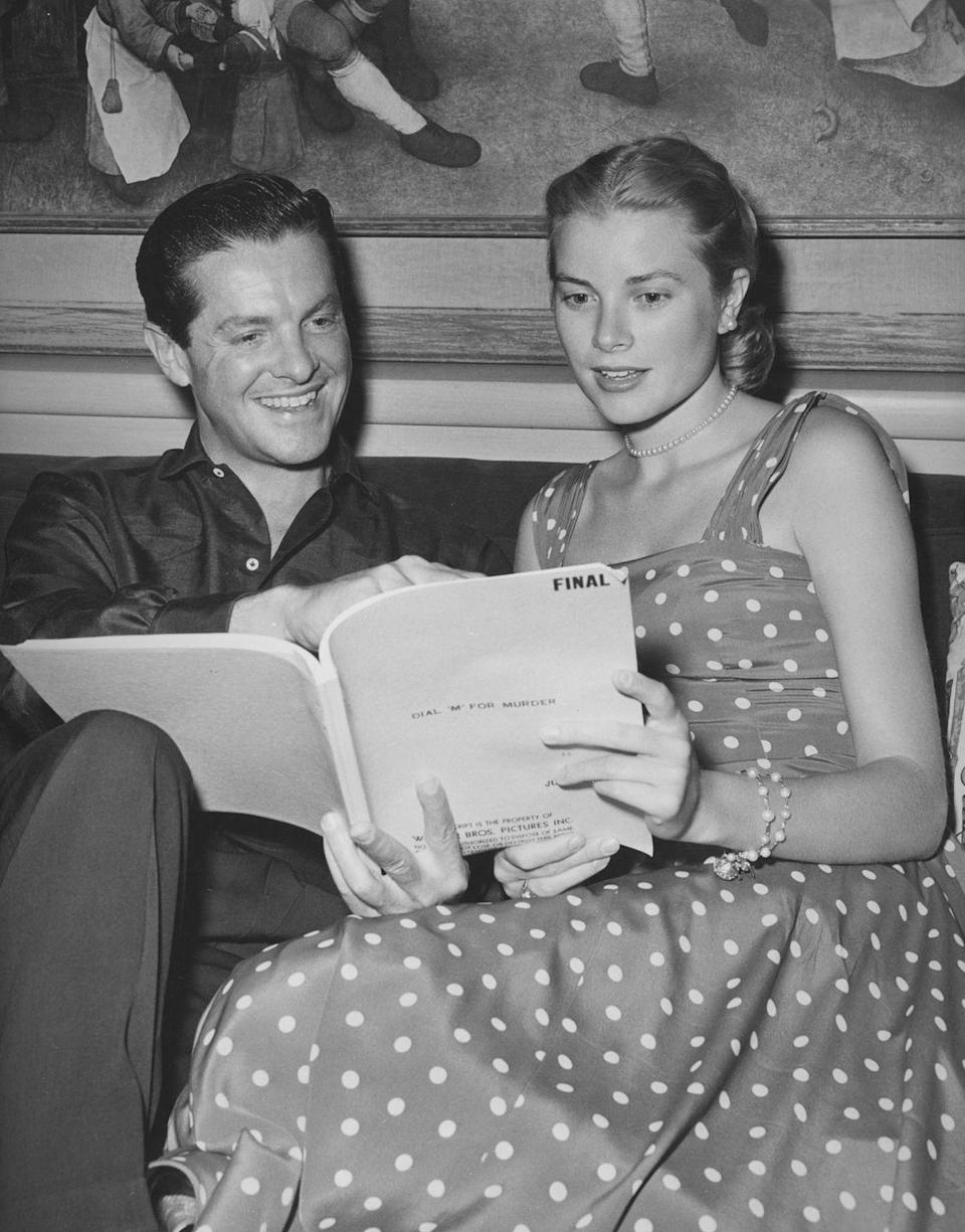 <p>The actress reads through the final script for Hitchcock's thriller, <em>Dial M for Murder, </em>with co-star Robert Cummings, in 1954. Naturally, the starlet looks impeccably chic in a sleeveless polka dot dress. </p>