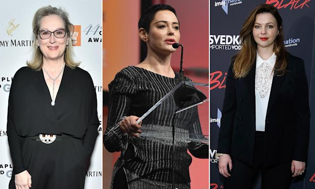 Amber Tamblyn, right, isn't happy with Rose McGowan, center, slamming Meryl Streep for reportedly planning to wear black to the Golden Globes in protest of sexual harassment. (Photos: Getty Images)