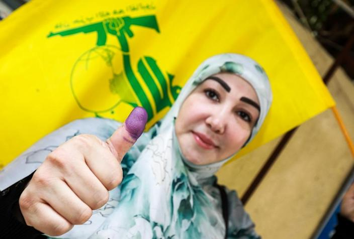 A 2018 general election confirmed Shiite militant group Hezbollah as a major political force in Lebanon but Britain has decided to ban it following an outcry over the display of its flag, which features a Kalashnikov assault rifle, at London rallies (AFP Photo/ANWAR AMRO)