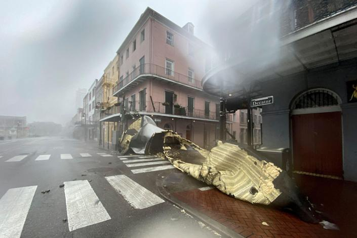 A section of a building's roof is seen after being blown off during rain and winds in the French Quarter of New Orleans after Hurricane Ida made a landfall (AFP via Getty Images)