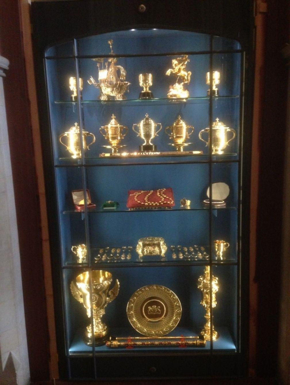 The display cabinet showing the stolen treasures although police say that not all items shown were taken (Sussex Police/PA)