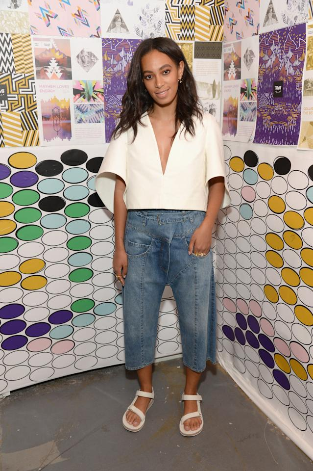 <p>Drop-crotch patchwork denim culottes, an origami-like wide quarter-length-sleeve top and Tevas sounds like a hot mess of an outfit, but Solange miraculously made the look work. And dare we say, we kind of want to try this ensemble for ourselves, though we doubt we'd be able to pull it off with the cool finesse Solange just hit us with. <i>(Photo: Getty)</i></p>