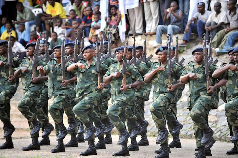 Soldiers attend a decoration ceremony for new lieutenants at a military academy in the city of Kananga, capital of central DR Congo province of Kasai-Central, on January 11, 2013
