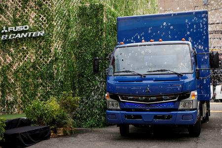 A new Daimler AG, FUSO battery-powered eCanter urban delivery truck is unveiled during a news conference in New York