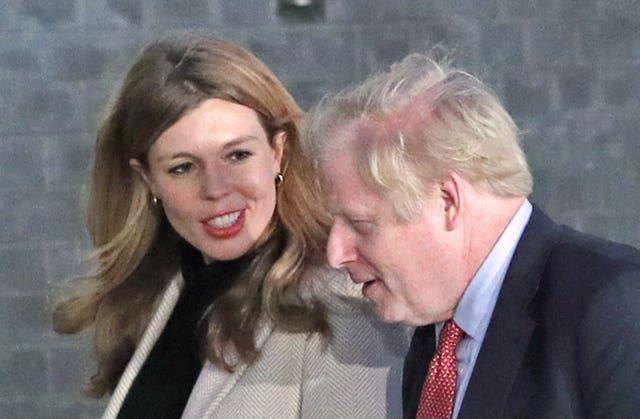 Boris Johnson and his fiancee Carrie Symonds arrive in Downing Street