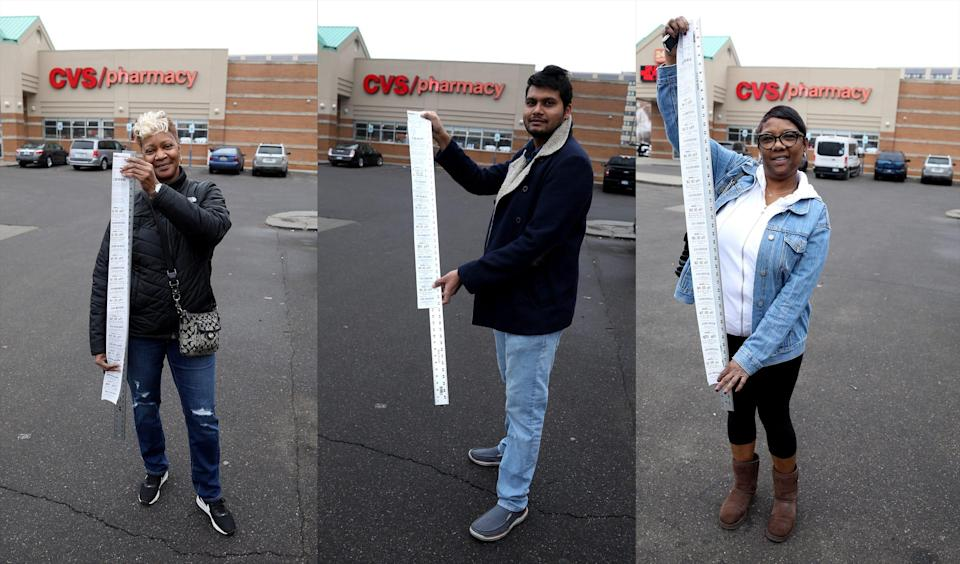 From left, Vikki Jackson, 59, Suneth Jayawardana, 29, and Stacie Jackson, 52, all from Detroit stand in front of the CVS Pharmacy on West Warren in Detroit Dec. 24, 2019, with their long receipts from the store. Jackson's receipt was 41 inches long, Jayawardana's receipt was 33 1/2 inches and Jackson's receipt was 44 inches.