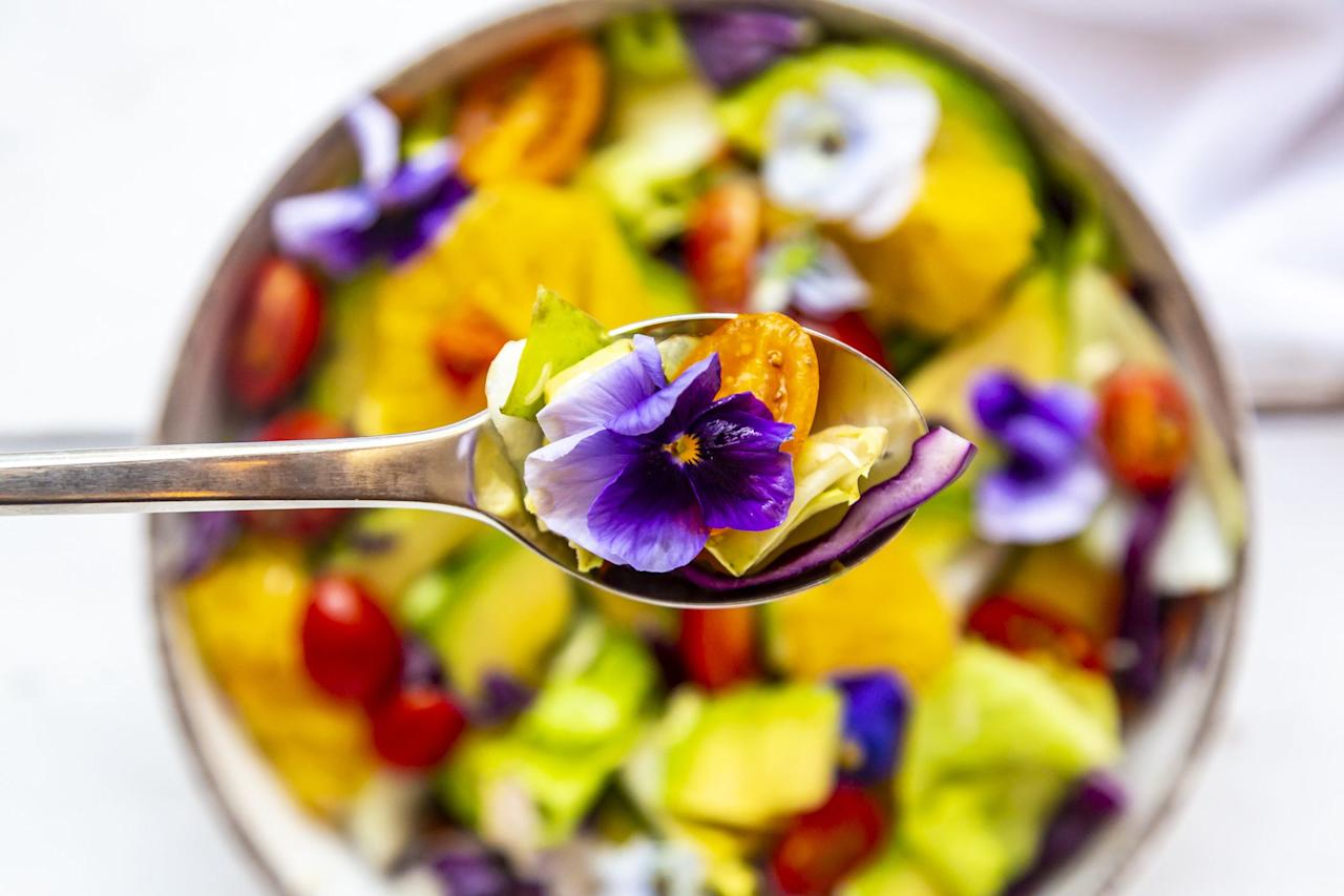 """<p>Not long ago, edible flowers were reserved for fancy bakeries and Michelin-starred restaurants. And then Instagram happened. Fun as decorating your <a href=""""https://www.womenshealthmag.com/food/a24733894/are-acai-bowls-healthy/"""" target=""""_blank"""">smoothie bowls</a> and other eats with edible flowers may be, though, it's not a total free-for-all. (No, you can't just turn any old bouquet into a salad.) <br></p><p>""""The term, 'edible' simply indicates that the flower was grown in a food-safe way, meaning it wasn't treated with unsafe pesticides or preservatives,"""" explains <a href=""""https://www.jwu.edu/campuses/providence/faculty-and-staff/seyfarth-todd.html"""">Todd Seyfarth</a>, RD, dietitian, chef, chair of the Department of Nutrition and Dietetics at Johnson & Wales University. """"It also means that the flower doesn't naturally contain any compounds we've identified as dangerous or toxic."""" <br></p><p>Not all edible flowers are actually worth eating, though. """"Often, plants with vivid and deep colors are bitter on the palate, so [appreciation for their taste] will vary from person to person,"""" says Seyfarth. If you're not a fan of bitter flavor, you'll probably want to remove those deep-hued petals from your food after snapping a pic for the 'gram. </p><p>That said, deeply-colored flowers are often the most nutrient-rich (like all edible plants, edible flowers contain important vitamins and minerals). """"The more colorful the plant and deeper the flavor, the more <a href=""""https://www.womenshealthmag.com/beauty/g28108633/best-antioxidant-serums/"""" target=""""_blank"""">antioxidant power</a> the plant usually has,"""" Seyfarth says. </p><p>If you're intrigued by flowering up your food, make sure to only purchase flowers marked as edible. """"They are harder to find, but gourmet grocers usually have them,"""" says Seyfarth.</p><p>From there, you'll want to prep your flowers a little differently than other fruits and vegetables. """"Most flowers are very delicate and will be damaged by rough washing"""