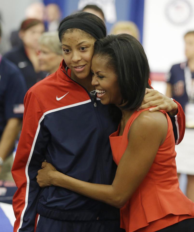 First lady Michelle Obama hugs women's basketball player Candace Parker after speaking at a breakfast with Team USA at the 2012 Summer Olympics, Friday, July 27, 2012, in London. (AP Photo/Darron Cummings)