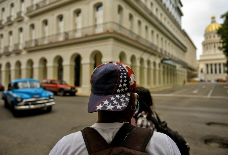 A man wearing a cap with a US flag design walks along a street of Havana, on November 3, 2020, the day of the American presidential election