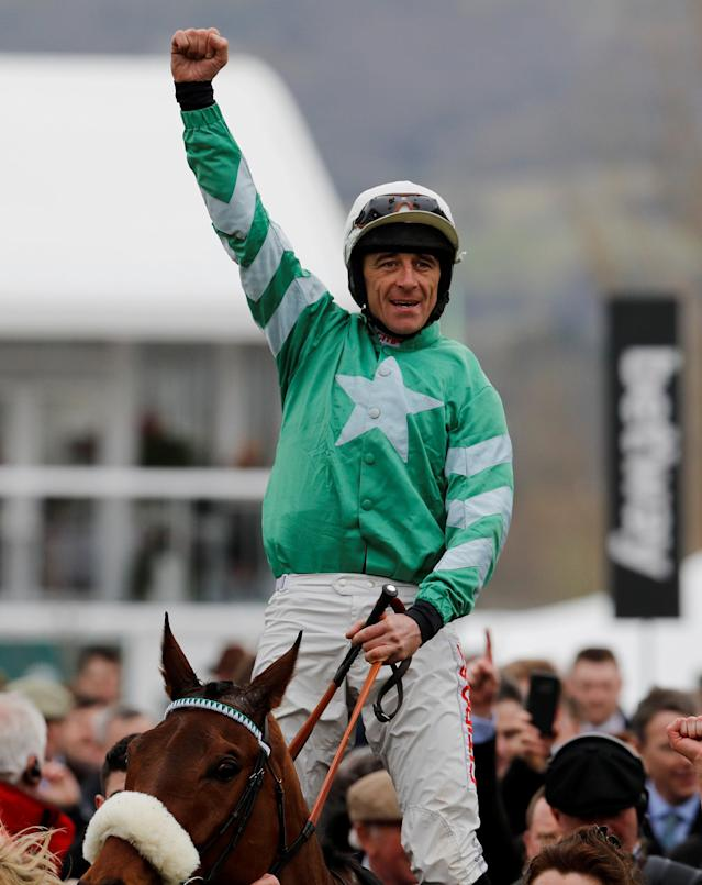 Horse Racing - Cheltenham Festival - Cheltenham Racecourse, Cheltenham, Britain - March 14, 2018 Davy Russell celebrates after riding Presenting Percy to victory in the 14:10 RSA Insurance Novices' Chase REUTERS/Darren Staples