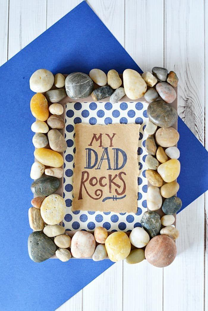 """<p>It's a card, craft and gift in one! Make sure you take a Father's Day picture together so he has a new photo to put in this frame.</p><p><a href=""""https://mommymoment.ca/my-dad-rocks-frame/"""" rel=""""nofollow noopener"""" target=""""_blank"""" data-ylk=""""slk:Get the tutorial at Mommy Moment »"""" class=""""link rapid-noclick-resp""""><em>Get the tutorial at Mommy Moment »</em></a></p>"""