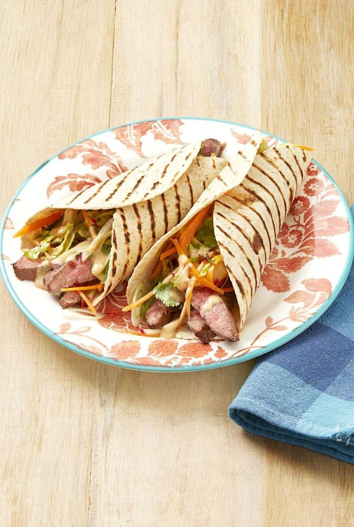 """<p>Take leftover grilled skirt steak and add to a wrap, alongside veggies and peanut sauce, for a satisfying weekday lunch.</p><p><a href=""""https://www.thepioneerwoman.com/food-cooking/recipes/a32501112/grilled-steak-wraps-with-peanut-sauce-recipe/"""" rel=""""nofollow noopener"""" target=""""_blank"""" data-ylk=""""slk:Get Ree's recipe."""" class=""""link rapid-noclick-resp""""><strong>Get Ree's recipe.</strong></a></p>"""