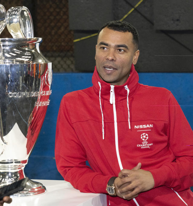 Ashley Cole with Champions League trophy (Credit: Nissan)