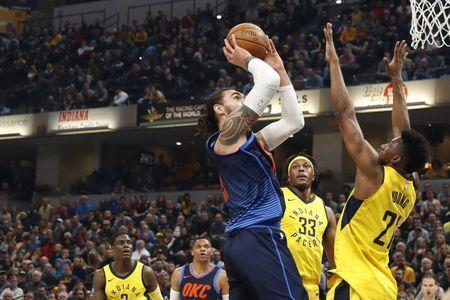 Dec 13, 2017; Indianapolis, IN, USA; Oklahoma City Thunder center Steven Adams (12) takes a shot against Indiana Pacers forward Thaddeus Young (21) during the first quarter at Bankers Life Fieldhouse. Brian Spurlock-USA TODAY Sports