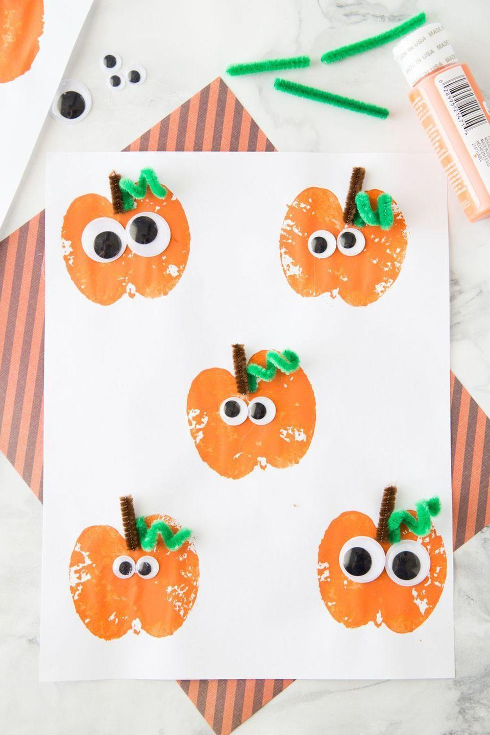 """<p>Take a few leftover apples from your orchard haul and turn them into adorable pumpkin-shaped stamps. Then bring your pumpkin shapes to life with pipe cleaners and googly eyes. </p><p><em><a href=""""https://www.madetobeamomma.com/apple-stamping-pumpkin-craft/"""" rel=""""nofollow noopener"""" target=""""_blank"""" data-ylk=""""slk:Get the tutorial at Made to be a Momma »"""" class=""""link rapid-noclick-resp"""">Get the tutorial at Made to be a Momma »</a></em></p>"""