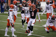 Cincinnati Bengals quarterback Joe Burrow (9) reacts after running for a first down during the second half of an NFL football game against the Cleveland Browns, Sunday, Oct. 25, 2020, in Cincinnati. (AP Photo/Michael Conroy)