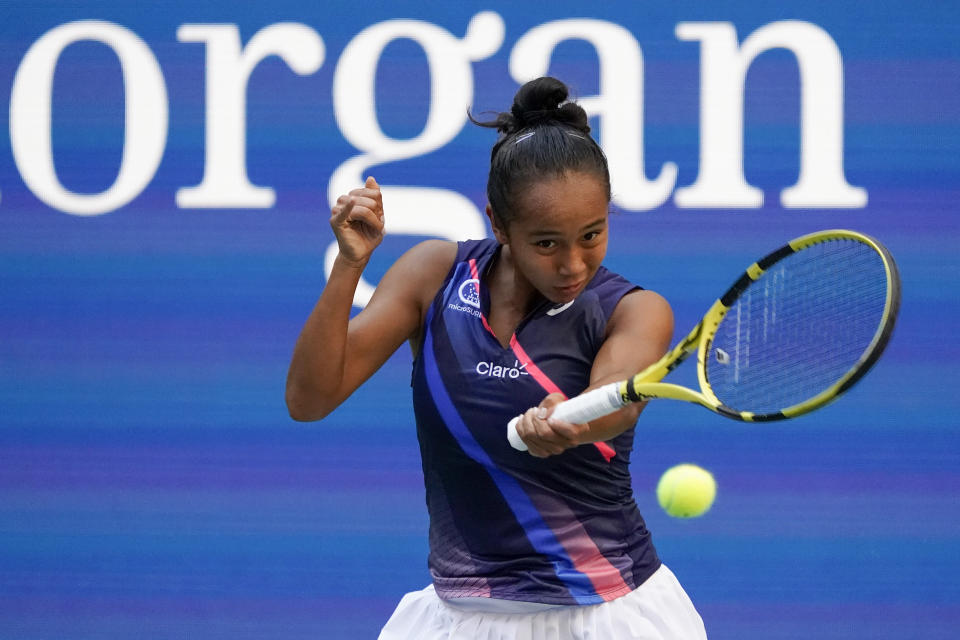 Leylah Fernandez, of Canada, returns a shot to Elina Svitolina, of Ukraine, during the quarterfinals of the US Open tennis championships, Tuesday, Sept. 7, 2021, in New York. (AP Photo/Elise Amendola)