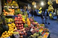FILE PHOTO: People wearing protective face masks walk at a local market in Istanbul