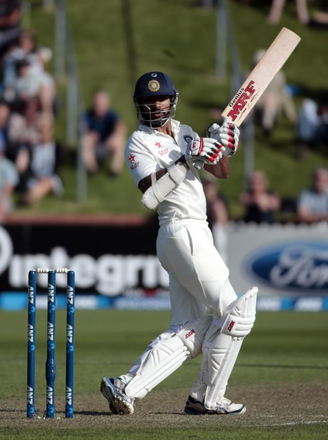 India's Shikhar Dhawan plays a shot against New Zealand during the first innings on day one of the second international test cricket match at the Basin Reserve in Wellington, February 14, 2014. REUTERS/Anthony Phelps (NEW ZEALAND - Tags: SPORT CRICKET)