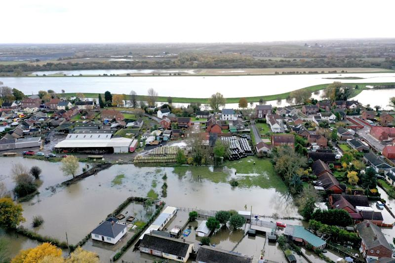 A view of the flood water at Fishlake, in Doncaster, South Yorkshire, as parts of England endured a month's worth of rain in 24 hours, with scores of people rescued or forced to evacuate their homes (PA)