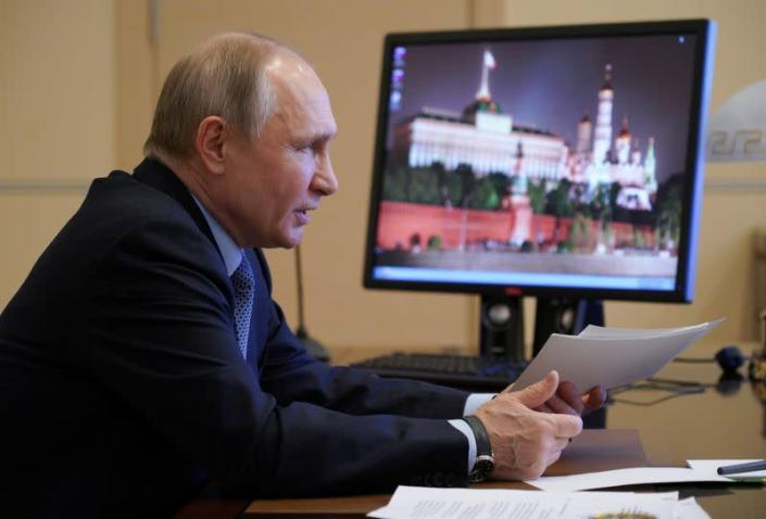 Russian President Vladimir Putin chairs a meeting outside Moscow