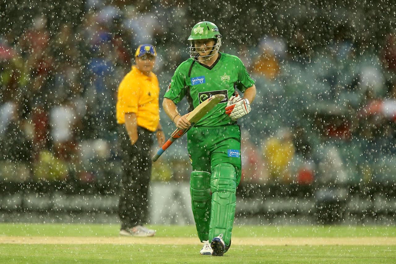 PERTH, AUSTRALIA - DECEMBER 12: Luke Wright of the Stars heads from the field as heavy rain sets in during the Big Bash League match between the Perth Scorchers and the Melbourne Stars at WACA on December 12, 2012 in Perth, Australia.  (Photo by Paul Kane/Getty Images)