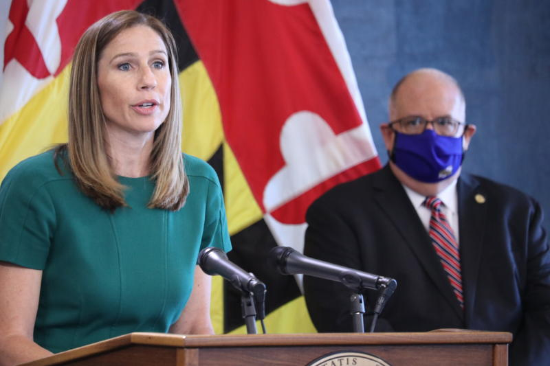 Maryland Labor Department Secretary Tiffany Robinson talks about the state's uncovering of more than 47,500 fraudulent unemployment insurance claims totaling more than $501 million at a news conference in Annapolis, Md., on Wednesday, July, 15, 2020. Gov. Larry Hogan is standing right. (AP Photo/Brian Witte