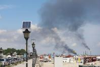 Smoke rises from crude oil refinery Petromidia following a blast and fire